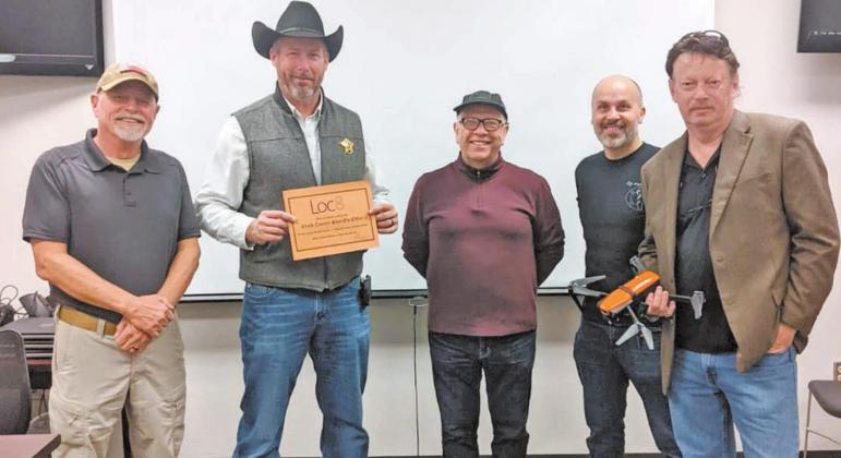 Gene Robinson (left), Mario Cugini (center), Antonio Cugini (second from right) and Marc Langley (right) presented Erath County Sheriff Matt Coates with a drone and other equipment to help better protect lives in a meet-up on Jan. 20. The donation was facilitated through the Life in the Arena Foundation and the National Public Safety Drone Donation Program and partners, FoxFury Lighting Solutions and Loc8. | submitted photo