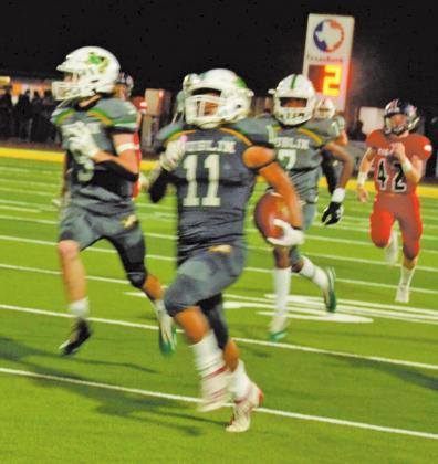 Dublin Lion Christian Ramirez is flanked by blockers Chris Teten and Javion Ray as he runs a 94-yard reception to the Anson Tiger goal line during Friday night's home game. Paul Gaudette | Citizen staff photo